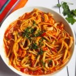 Spicy Seafood Pasta | This Spicy Seafood Pasta is packed full of flavour with juicy prawns and calamari in a rich tomato sauce with a kick of chilli and chopped basil. Gluten and dairy free too.