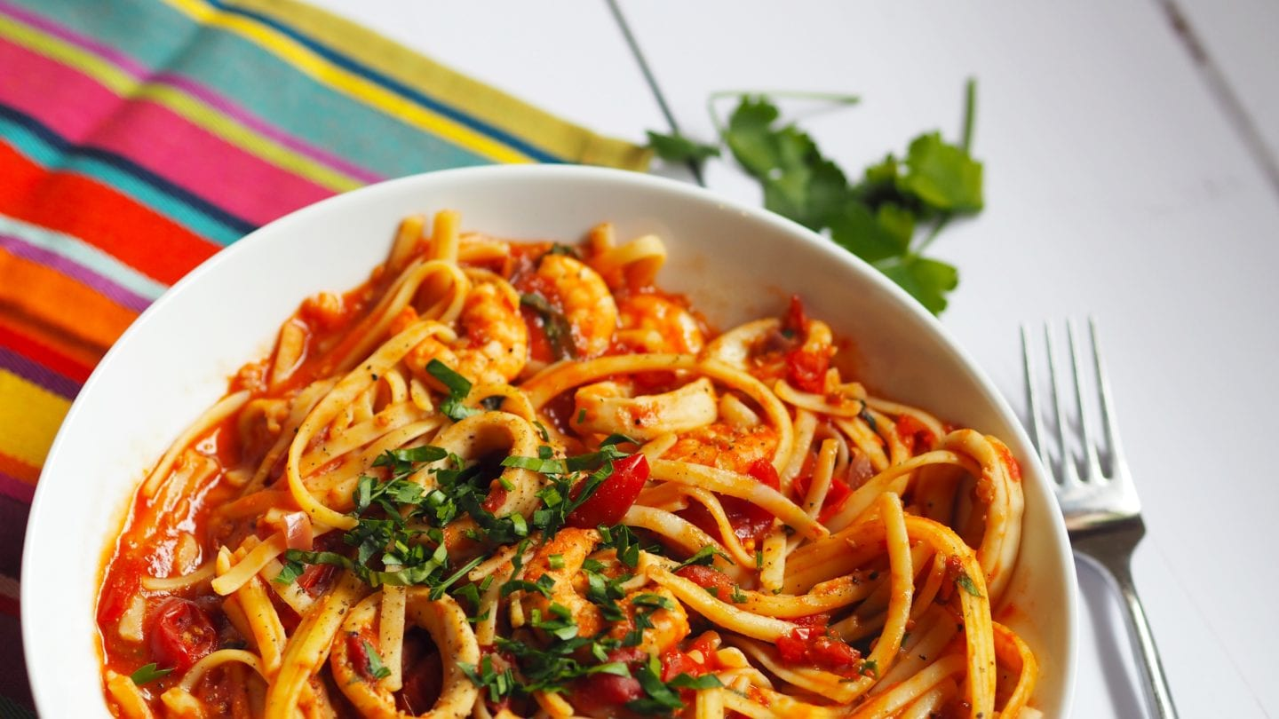 This Spicy #Seafood #Pasta #recipe is packed full of flavour with juicy #prawns and #calamari in a rich tomato sauce with a kick of chilli and chopped basil. #Gluten and #dairy #free too. #syn #free on #slimming #world